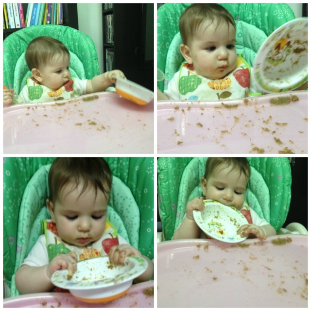 baby girl messing around with her plate of foo