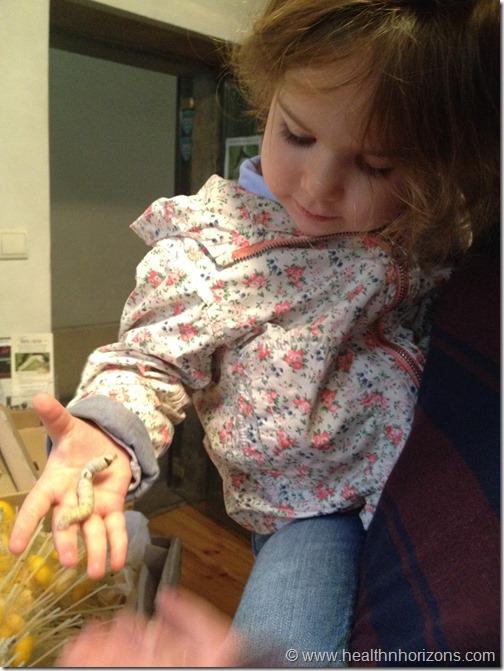 my girl holding a caterpillar